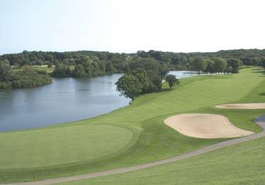 Outdoor golf course by lake at Lake Geneva Resort