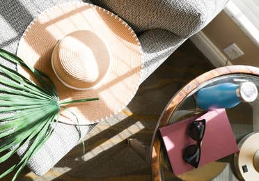 Closeup of table with sunglasses and sun hat in West Village at Orange Lake Resort near Orlando, FL