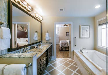 Bathroom with a bath and double vanity in a three-bedroom Signature Collection villa at South Beach Resort in Myrtle Beach, South Carolina.