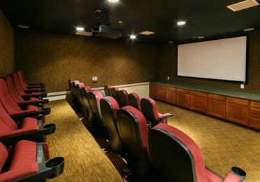 Movie theater with red seats at Orlando Breeze Resort in Florida.