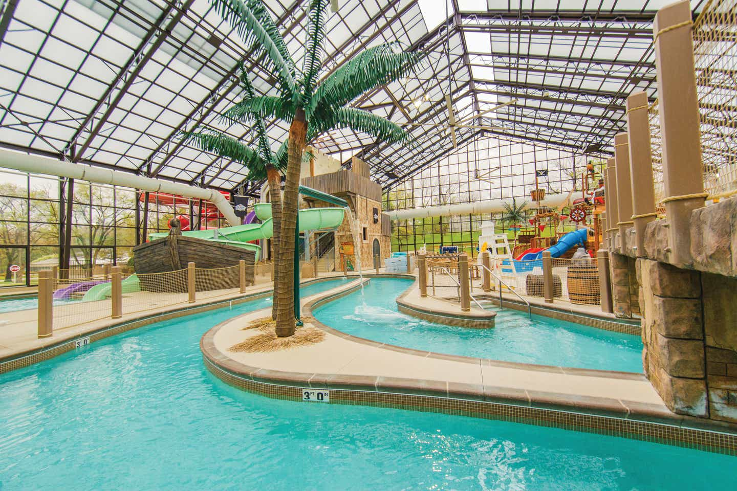 Indoor lazy river and water feature at Pirate's Cay Water Park at Fox River Resort in Sheridan, Illinois