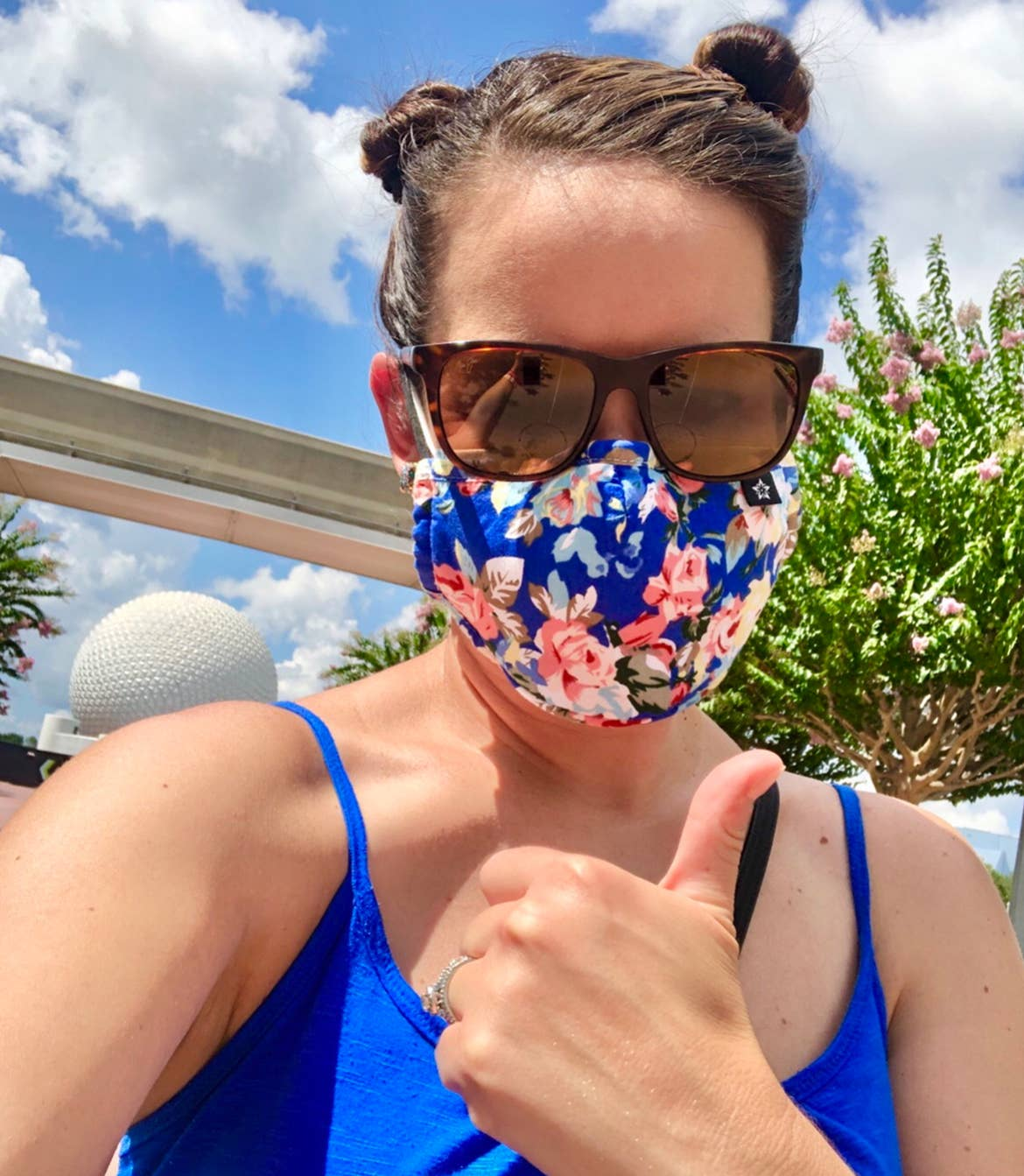 Jenn appears in front of the Monorail and Spaceship Earth at Epcot.