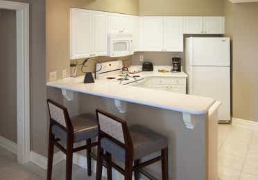Kitchen with fridge, oven and microwave in a two-bedroom villa at Galveston Beach Resort