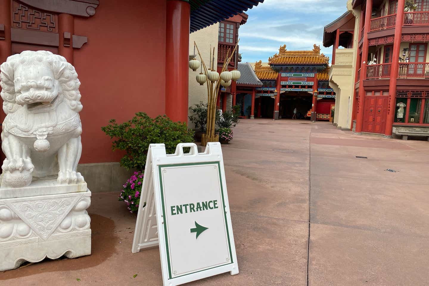 Exterior shot of the China Pavilion at Epcot-World Showcase with an Entrance sign indicating the shop is open.