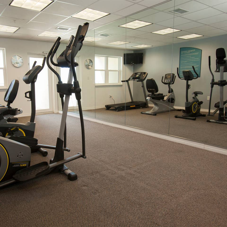 Fitness center with treadmills, stationary bicycles and ellipticals at Panama City Beach Resort in Florida.