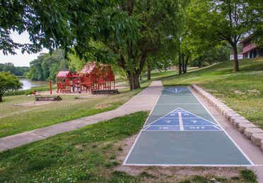 Outdoor shuffleboard court and children's playground at Fox River Resort in Sheridan, Illinois