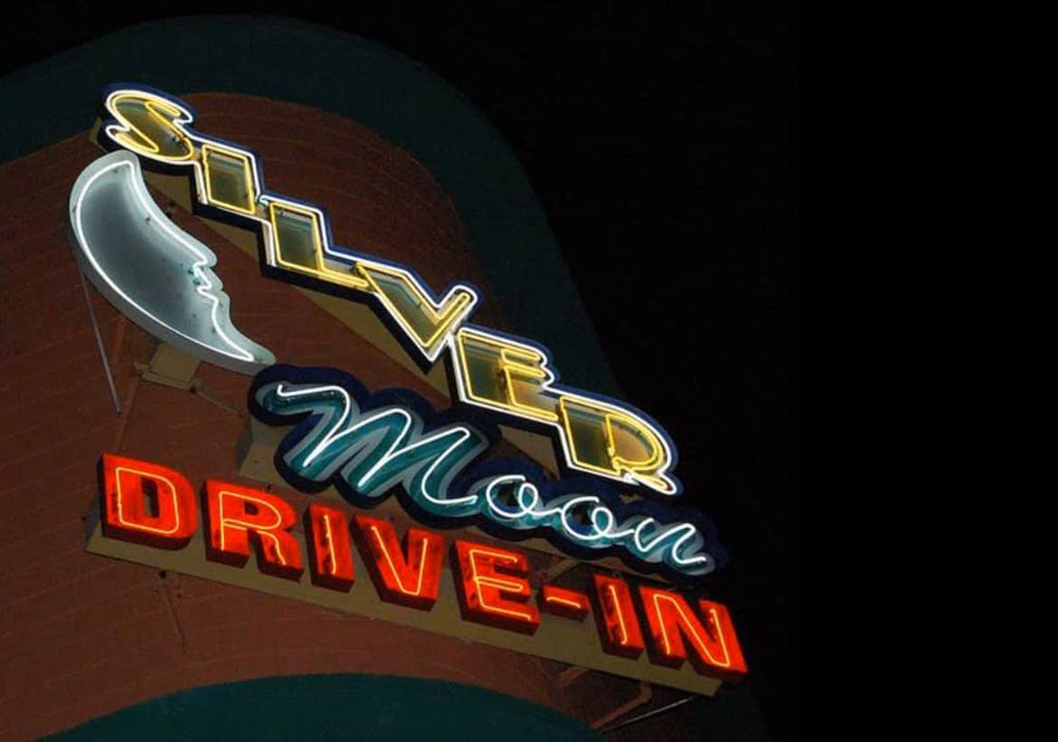 Entrance sign for the Silver Moon Drive-In theater