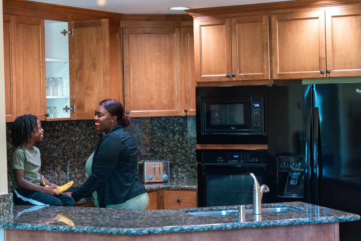 Karen and her son spending time in the kitchen of their Tahoe Ridge Resort villa.