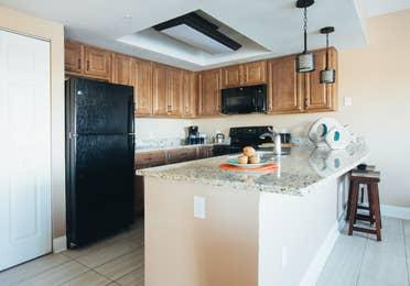 Kitchen with fridge, sink, oven, and microwave in West Village at Orange Lake Resort near Orlando, FL