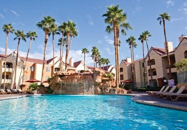 Outdoor pool with waterfall at Desert Club Resort in Las Vegas