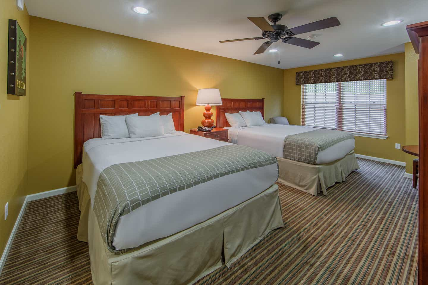 Two queen beds with a window view in a studio villa at Fox River Resort in Sheridan, Illinois