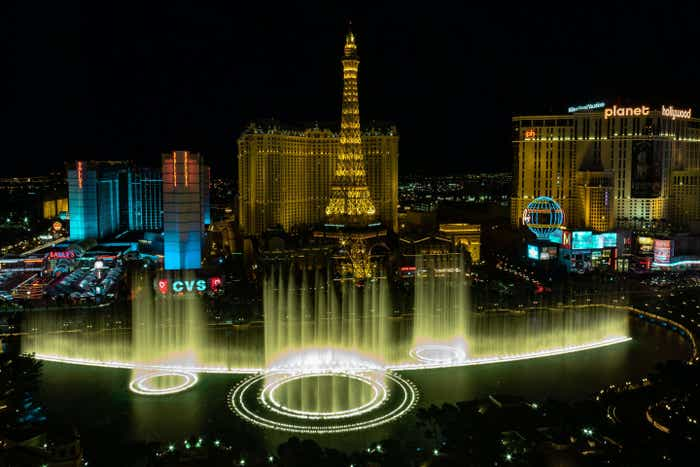 the Las Vegas strip at night with lights and the Bellagio 'Dancing fountains.'