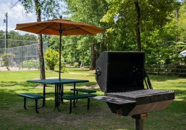 Barbecue grill and picnic table at Villages Resort in Flint, Texas.