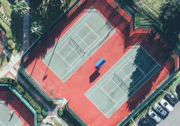 Aerial view of two outdoor tennis courts in West Village at Orange Lake Resort near Orlando, Florida