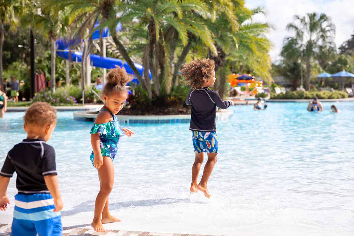 Featured Contributor, Sally Butan's children enter the pool at our Orange Lake resort located near Orlando, FL.
