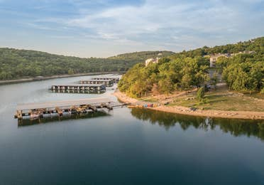 View of lake and boat dock at Ozark Mountain Resort in Kimberling City, MIssouri.