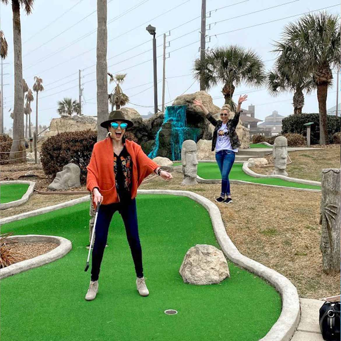 Featured Contributor, Amanda Nall (right) plays mini-golf with her friend at our Galveston Beach Resort in Galveston, Tx.