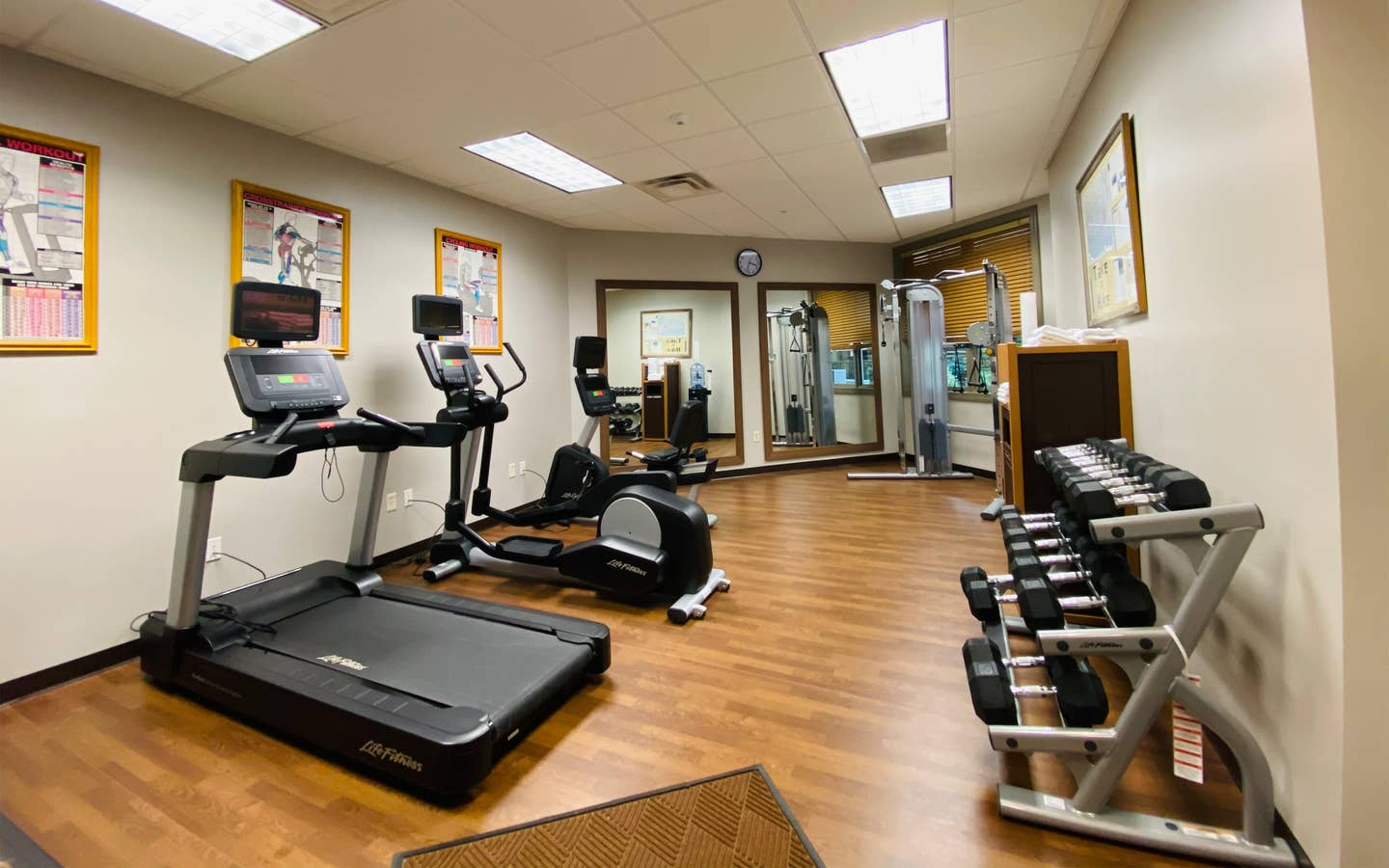 Fitness center with a treadmill, stationary bicycle, elliptical and free weights at Smoky Mountain Resort in Gatlinburg, Tennessee.