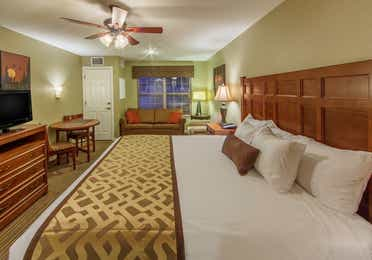 King bed and flat screen TV in a studio room at Piney Shores Resort in Conroe, Texas