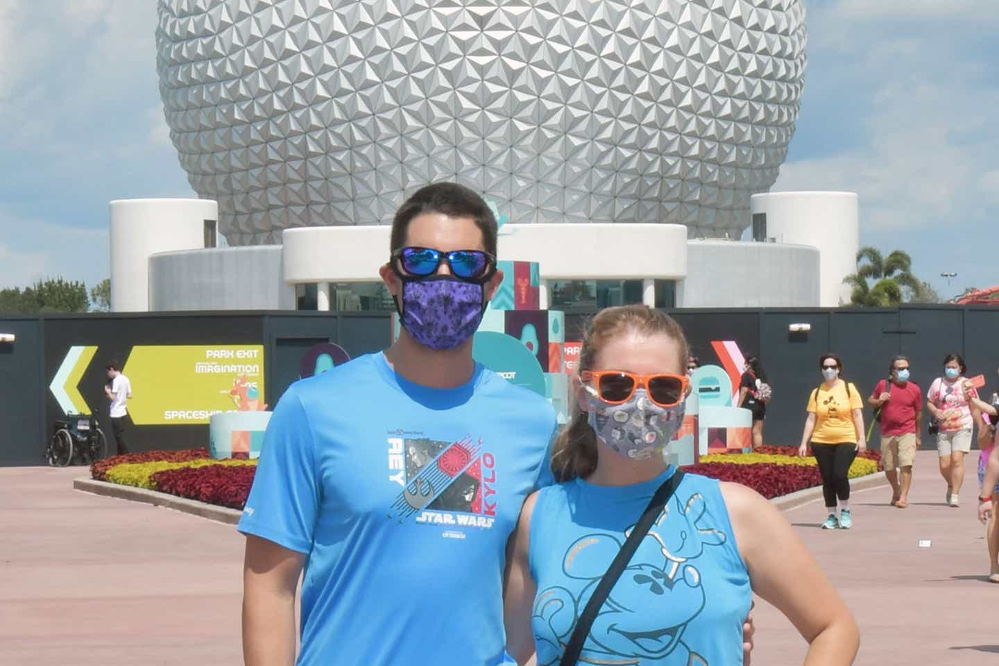 Featured author, Jessica Salina, and her Husband stand in front of Spaceship Earth at EPCOT at Walt Disney World resort.
