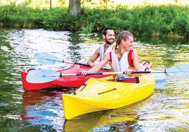 A man and woman kayaking near Orange Lake Resort in Orlando, Florida