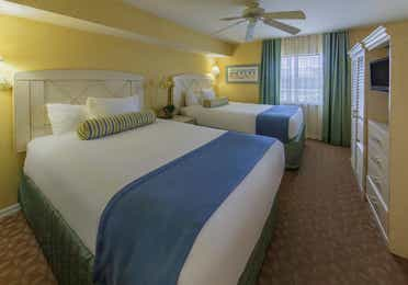 Guest bedroom with two double beds, flat screen TV, and window in a two-bedroom lock-off villa at Cape Canaveral Beach Resort