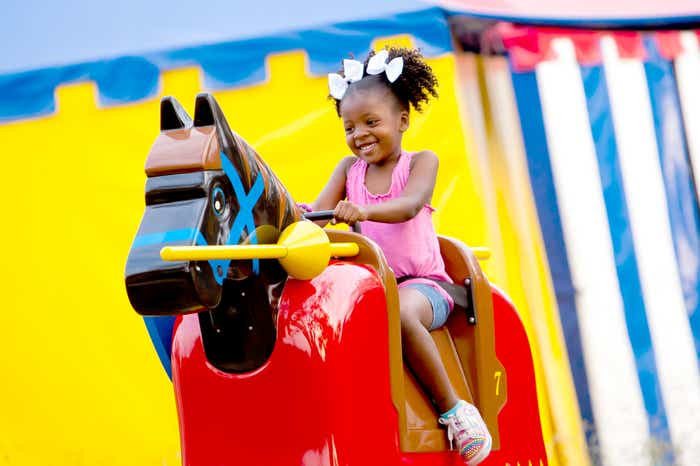 Small child riding mechanical horse at LEGOLAND Florida