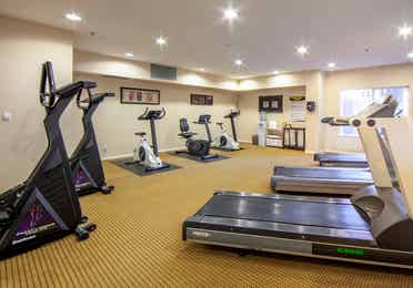 Fitness center with treadmills and elliptical bikes at David Walley's Resort in Genoa, Nevada