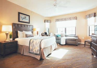 Bedroom with seating area in a three bedroom villa in West Village at Orange Lake Resort near Orlando, FL