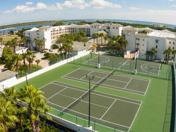 Aerial view of two tennis courts and a basketball court at Cape Canaveral Beach Resort.