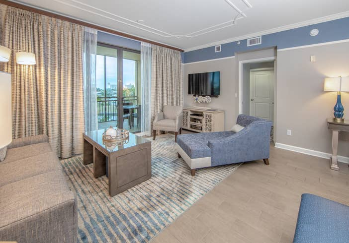 Living room with coastal decor and flat screen TV in a three-bedroom villa at Sunset Cove Resort in Marco Island, Florida