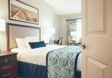 Bed with two nightstands in River Island at Orange Lake Resort near Orlando, Florida