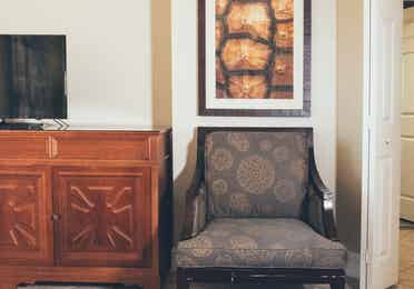 Closeup of accent chair in a Signature villa in River Island at Orange Lake Resort near Orlando, Florida
