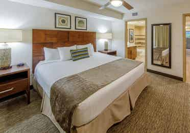 King bedroom with access to bathroom in a one-bedroom villa at Scottsdale Resort