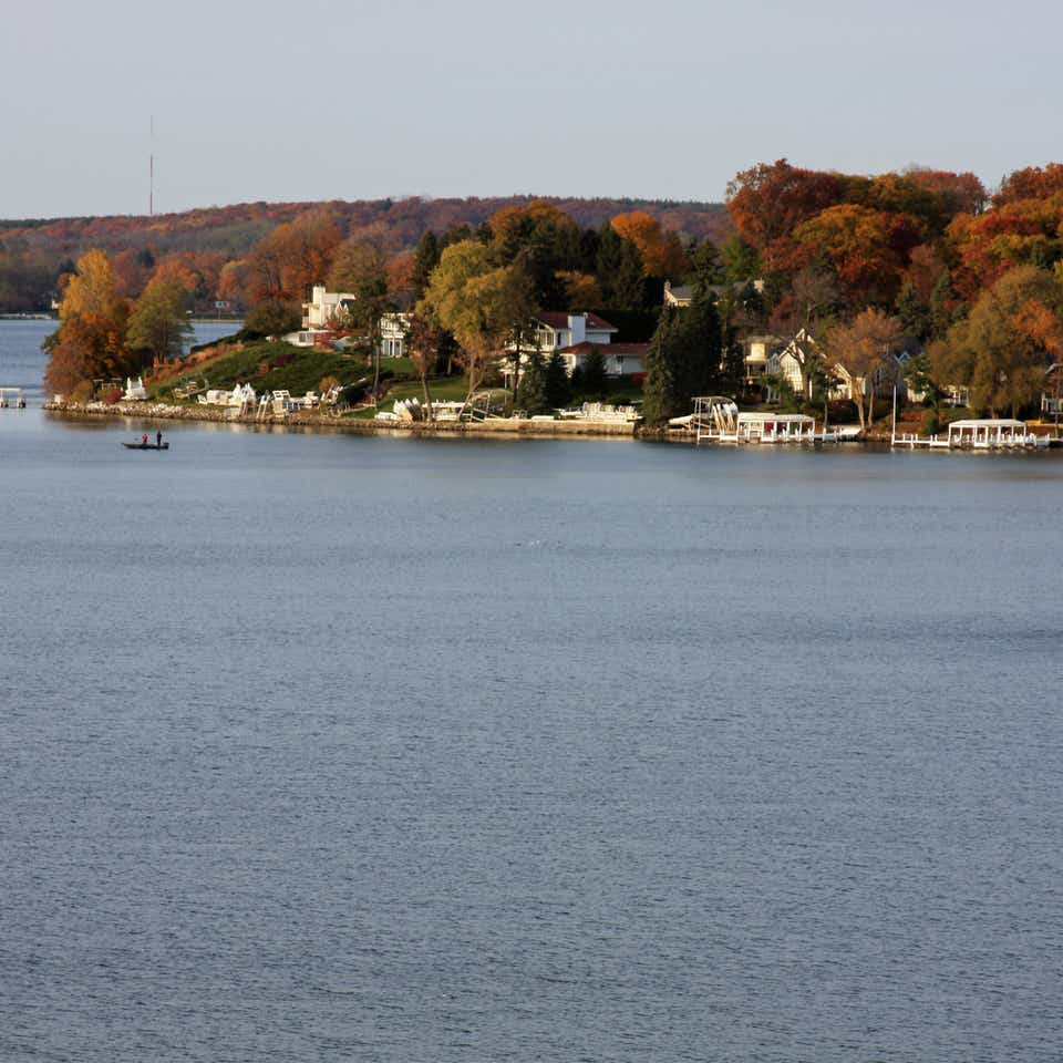 View of trees on edge of lake in Lake Geneva, Wisconsin.