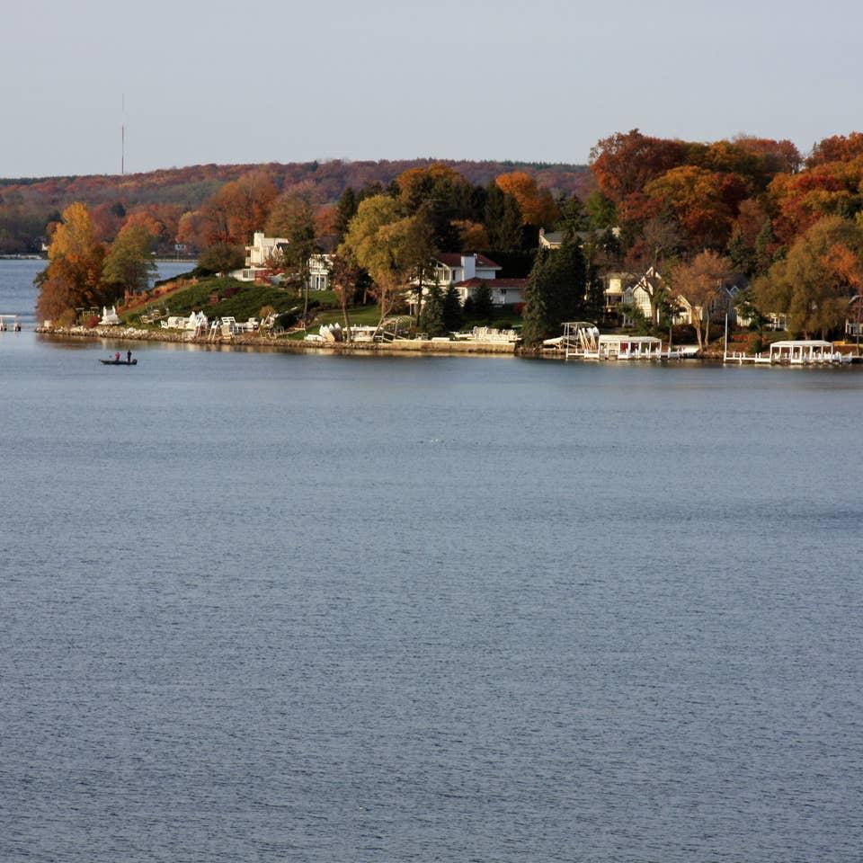 View of trees on edge of lake in Lake Geneva, Wisconsin.