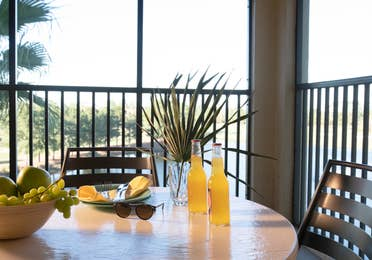 Furnished balcony with table and two chairs in a villa in East Village at Orange Lake Resort near Orlando, Florida