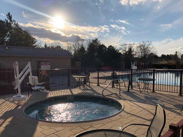 Outdoor hot tub beside pool at Apple Mountain Resort in Georgia.