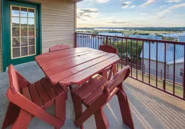 Balcony with table set in a three-bedroom ambassador villa at the Hill Country Resort in Canyon Lake, Texas.