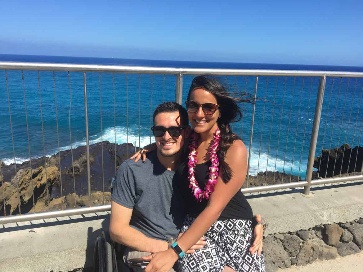 Danny and his wife at an overlook in front of the ocean in Hawaii.