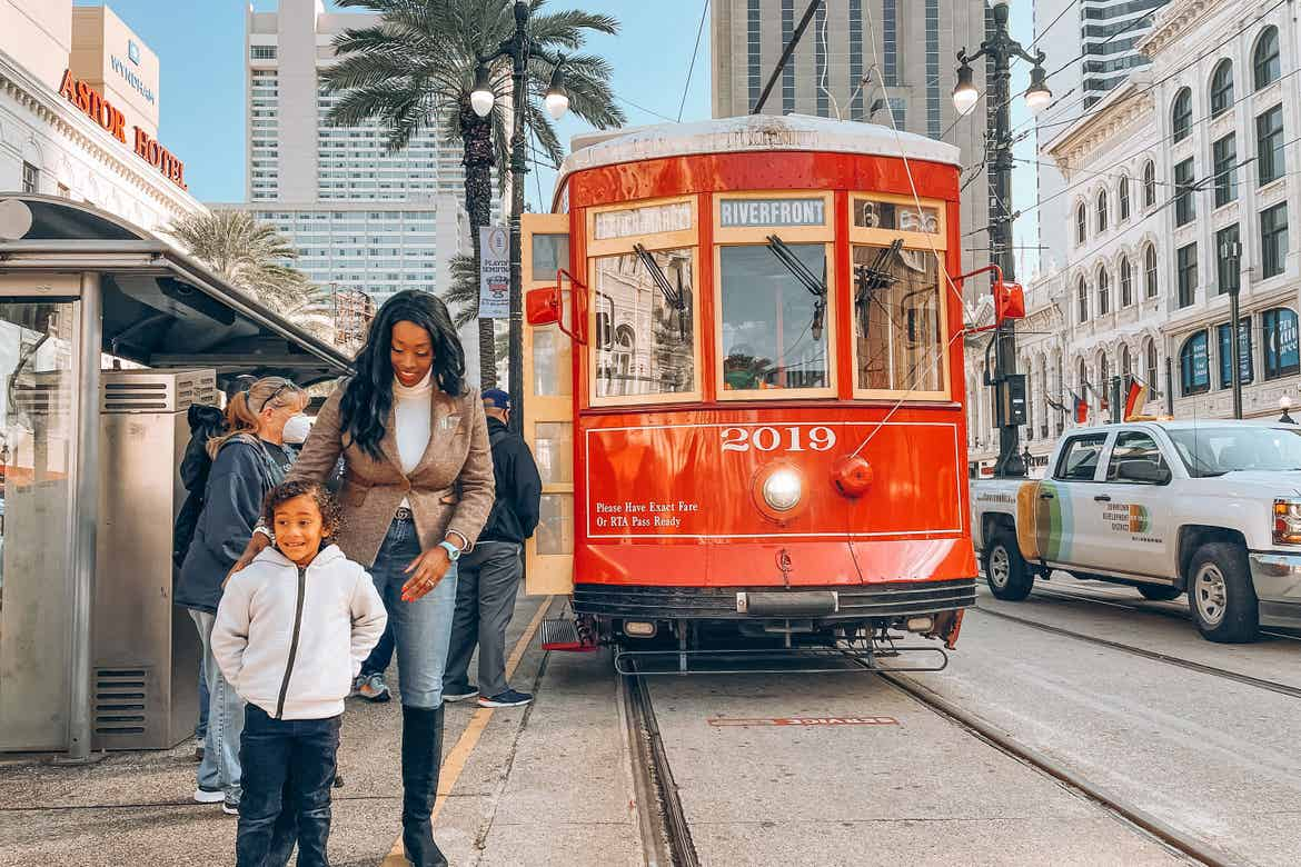 Featured Contributor, Sally Butan (left) of @butanclan stands with her son (left) in front of a streetcar outside the entrance of our resort in New Orleans, Louisiana.