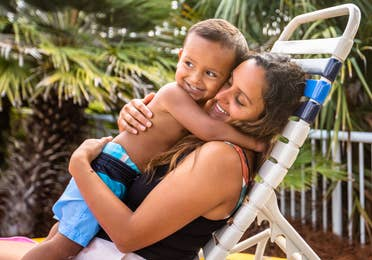 Author, Brenda Rivera Sterns (right) holds her son (left) in the pool chair at our South Beach Resort in Myrtle Beach, South Carolina.