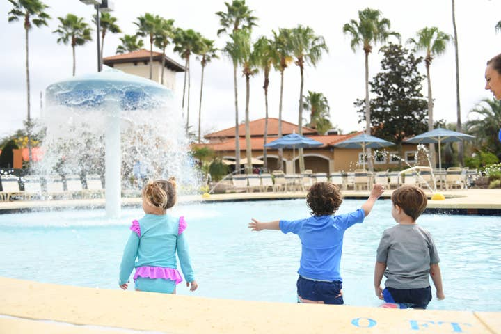 Three young kids enjoying the children's pool at Orange Lake Resort near Orlando, Florida