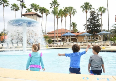 Three young kids enjoying the children's pool at Orange Lake Resort near Orlando, Florida