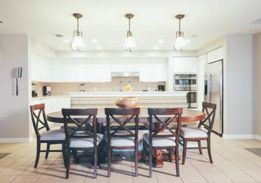 Large dining room table with eight chairs in a villa in River Island at Orange Lake Resort near Orlando, Florida