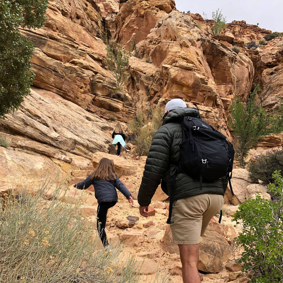 Kyler and Kyndall climb ahead of Josh up the Capitol Gorge Trail.