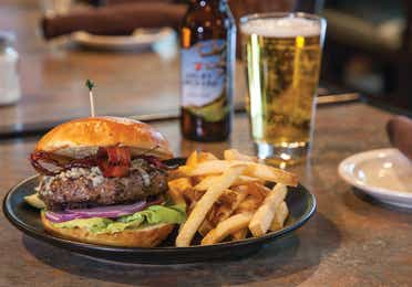 Burger and fries paired with a beer.