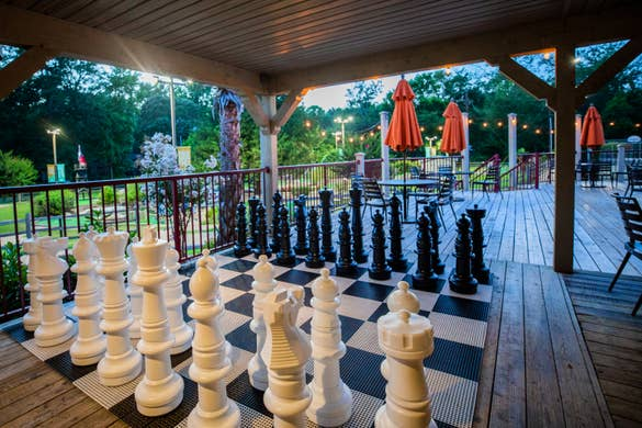 An oversized chess set near our Activities Outpost at our Villages Resort located in Flint, Texas.
