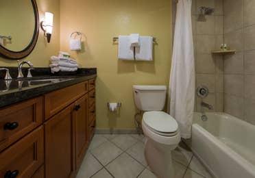 Bathroom with shower/tub combination in a studio room in West Village at Orange Lake Resort near Orlando, FL