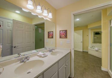 Bathroom with double sinks and large mirror in a one-bedroom Presidential villa at Hill Country Resort in Canyon Lake, Texas